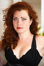 Ukrainian girl Margo,25 years old with blue eyes and red hair.