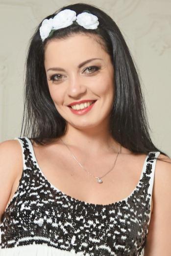 Ukrainian girl Inna,29 years old with hazel eyes and black hair.