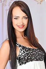 Ukrainian girl Ekaterina,27 years old with green eyes and black hair.