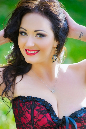 Ukrainian girl Julia,28 years old with hazel eyes and black hair.