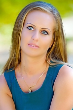 Ukrainian girl Alena,31 years old with grey eyes and light brown hair.