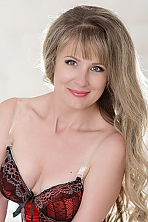 Ukrainian girl Natalia,48 years old with grey eyes and blonde hair.