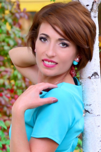 Ukrainian girl Ludmila ,39 years old with green eyes and dark brown hair.