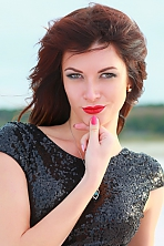 Ukrainian girl Elena,25 years old with green eyes and red hair.