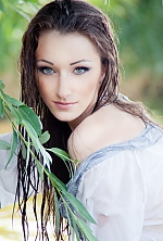 Ukrainian girl Katrin,23 years old with green eyes and dark brown hair.