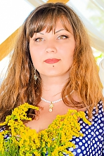 Ukrainian girl Tatyana,42 years old with brown eyes and dark brown hair.