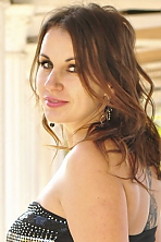 Ukrainian girl Irina,33 years old with green eyes and light brown hair.