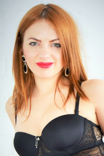 Ukrainian girl  Valentina,26 years old with green eyes and dark brown hair.
