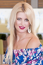 Ukrainian girl Nataliya,42 years old with green eyes and blonde hair.
