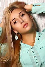 Ukrainian girl Vasylysa,21 years old with green eyes and blonde hair.