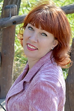 Ukrainian girl Lia,46 years old with green eyes and red hair.