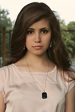 Ukrainian girl Alyona,20 years old with brown eyes and dark brown hair.