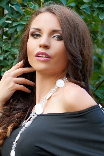 Ukrainian girl Anna,26 years old with green eyes and light brown hair.