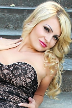 Ukrainian girl Eugenia,34 years old with green eyes and blonde hair.