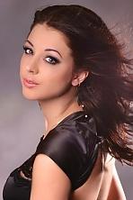 Ukrainian girl Tatyana,25 years old with grey eyes and dark brown hair.