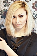 Ukrainian girl Julia,23 years old with black eyes and blonde hair.