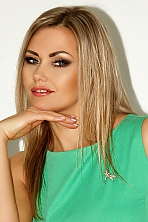 Ukrainian girl Tatyana,42 years old with blue eyes and blonde hair.