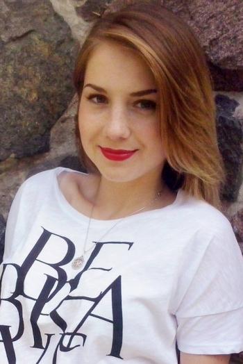 Ukrainian girl Mariya,21 years old with green eyes and light brown hair.