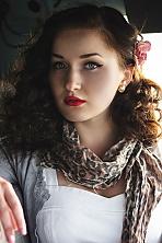 Ukrainian girl Myroslava,21 years old with blue eyes and dark brown hair.