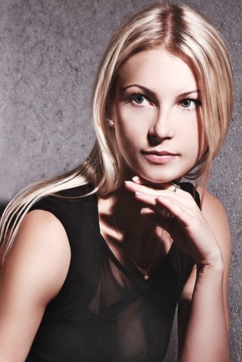Ukrainian girl Kristina,29 years old with green eyes and light brown hair.