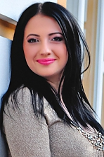 Ukrainian girl Maria,26 years old with brown eyes and black hair.