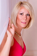 Ukrainian girl Natalya,38 years old with grey eyes and blonde hair.