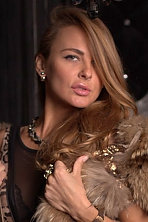 Ukrainian girl Karina,34 years old with blue eyes and dark brown hair.