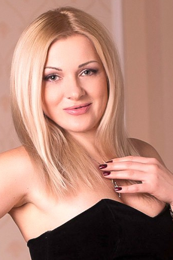 Ukrainian girl Svetlana,43 years old with grey eyes and blonde hair.