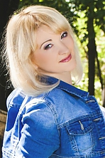 Ukrainian girl Alla,29 years old with green eyes and blonde hair.