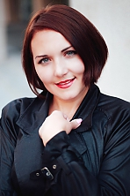 Ukrainian girl Elena,35 years old with grey eyes and auburn hair.