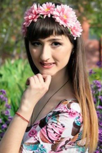 Ukrainian girl Alesya,22 years old with brown eyes and dark brown hair.