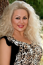 Ukrainian girl Tatiana,41 years old with grey eyes and blonde hair.
