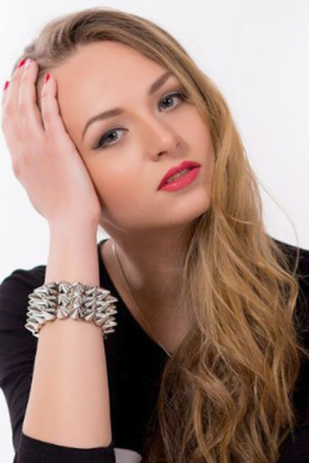 Ukrainian girl Adelina,20 years old with green eyes and blonde hair.