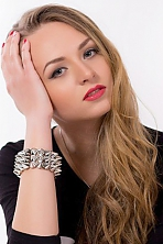 Ukrainian girl Adelina,19 years old with green eyes and blonde hair.