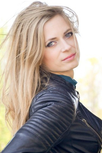 Ukrainian girl Anna,28 years old with grey eyes and blonde hair.