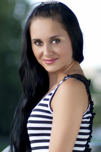 Ukrainian girl Ekaterina,28 years old with green eyes and black hair.