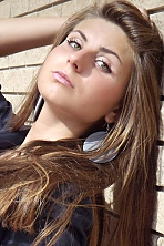 Ukrainian girl Alla,20 years old with green eyes and light brown hair.