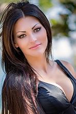 Ukrainian girl Inna,32 years old with brown eyes and dark brown hair.