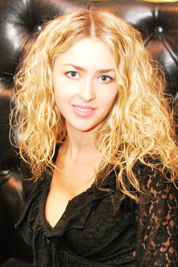 Ukrainian girl Karina,30 years old with green eyes and blonde hair.