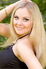 Ukrainian girl Anna,32 years old with green eyes and blonde hair.