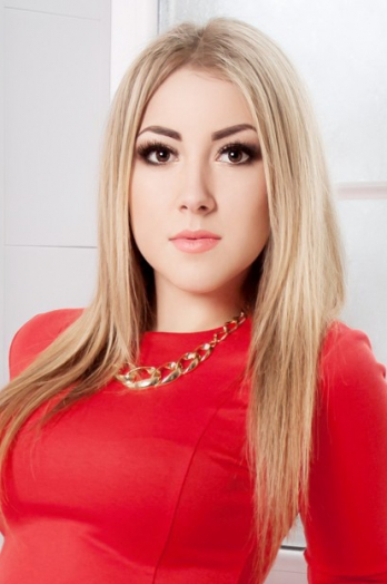 Ukrainian girl Elena,26 years old with brown eyes and blonde hair.