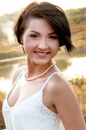 Ukrainian girl Marina,30 years old with brown eyes and black hair.