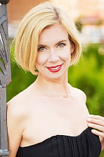 Ukrainian girl Vita,47 years old with grey eyes and blonde hair.