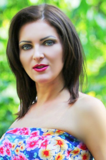 Ukrainian girl Irina,35 years old with blue eyes and light brown hair.