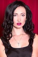 Ukrainian girl Olga,25 years old with grey eyes and dark brown hair.