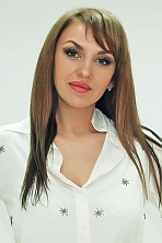 Ukrainian girl Galina,37 years old with green eyes and light brown hair.