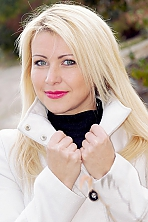 Ukrainian girl Irina,30 years old with grey eyes and blonde hair.