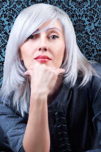 Ukrainian girl Irina,42 years old with grey eyes and blonde hair.