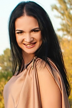 Ukrainian girl Alina,30 years old with brown eyes and black hair.