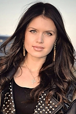 Ukrainian girl Snezhana,24 years old with blue eyes and dark brown hair.